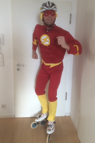 fastest inline skating marathon dressed as a superhero